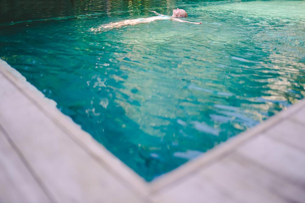 Emmi floating in liquid sun.