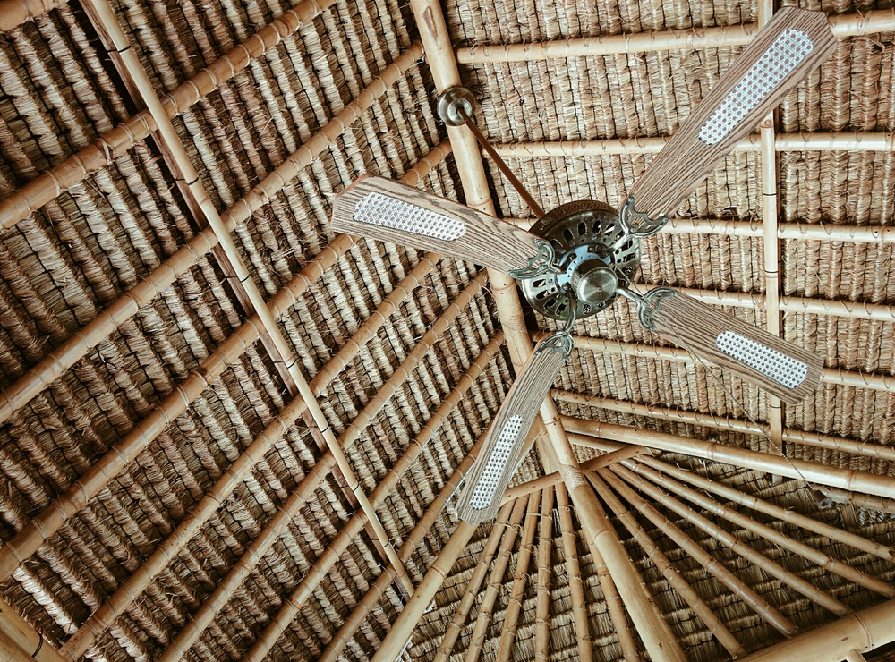 A traditional roof construction made out of thatched palm fibres and bamboo stalks at ARMA museum, Ubud, Bali .