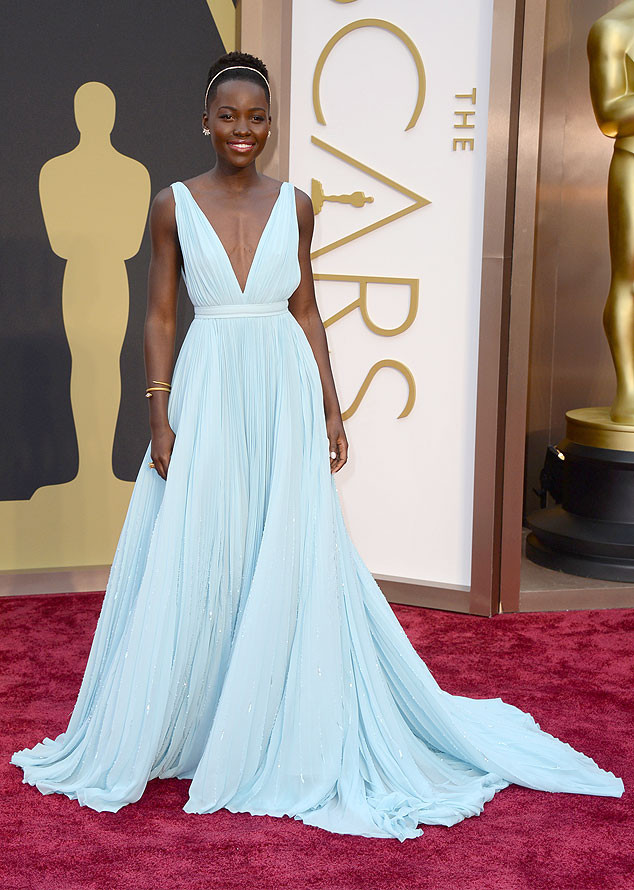 lupita nyong'o looked like a princess in prada! she helped design this dress and i really thing it looked stunning on her. lately she's been going with bold colors to award shows and this time she chose a light blue which was genius!