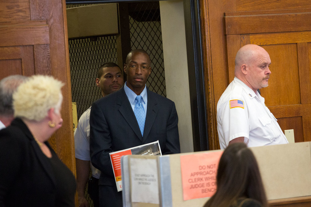 Sean Ellis enters the courtroom for his May 12, 2015 bail hearing at which Judge Carol S. Ball granted him $50,000 bail with the requirement to wear a GPS monitoring device.  The Commonwealth of Massachusetts announced its intention to appeal Judge Ball's ruling to overturn his convictions.