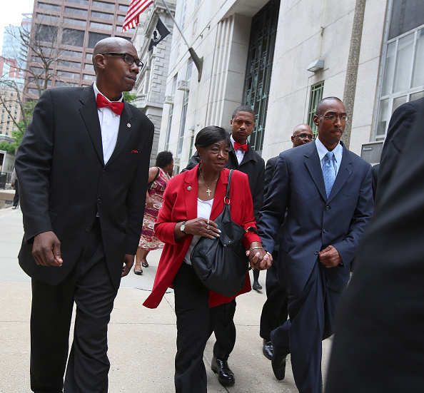 Free at last, June 3, 2015. Sean Ellis leaves Boston's Suffolk Superior Court holding his mother, Mary's, hand. Arrested at age 19, he spent more than half his life in prison for a crime he maintains he did not commit.  (Getty Images)