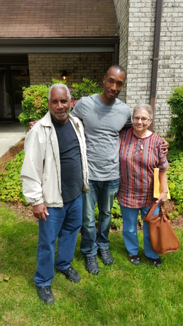 Sean in June 2015, flanked by transition counselors Lawrence Robinson and Lyn Levy of Span, Inc.