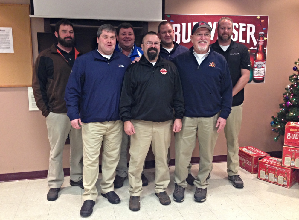 Company Holiday Party 2014. Service Awards (from left to right): Mike Dicus - 15 years, Timmy Ewing - 20 years, Leroy Frase - 30 years, John Beatty - 5 years, Robert Dietrich - 15 years, Byrd Dog Wheeler - 25 years, and Eric Lord - 15 years. Congratulations!