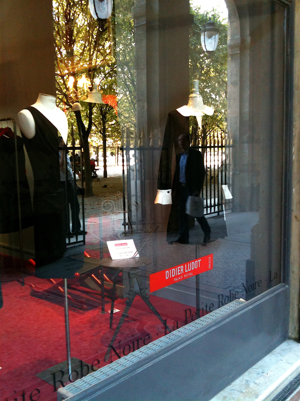 Window shopping in the Palais Royal, Paris. Photo: DelRae