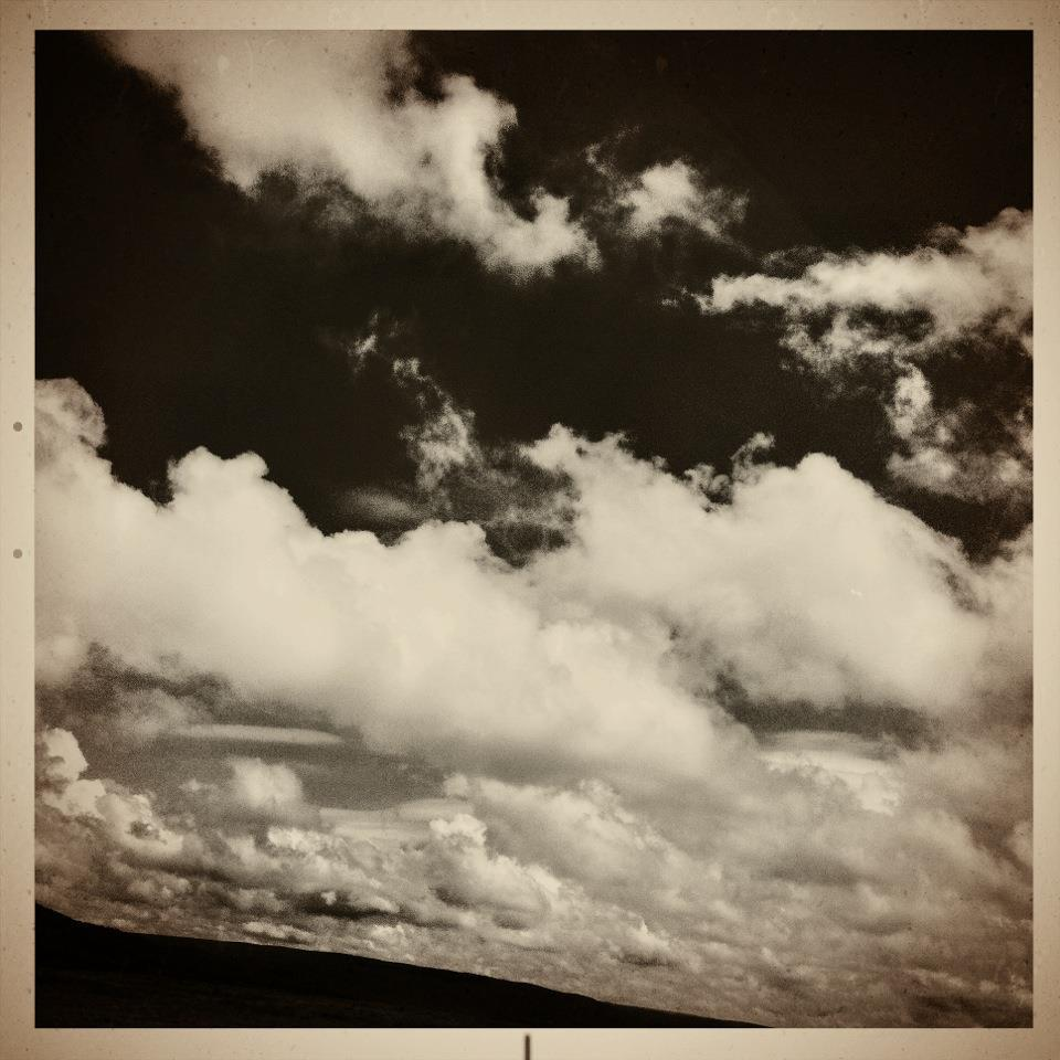iPhone (2013). An example of my fascination with clouds clouds clouds! Taken in New Mexico hills while teaching my son to drive by putting him behind the wheel in Memphis, TN and only letting him back out when he arrived in San Diego, CA.