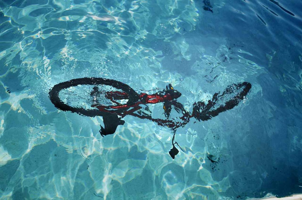 Electra Bicycles (2009). Creative & Photo Direction for 2009 International campaign. Photographer Art Brewer. The concept we created was that your Electra Bike becomes such an important part of your life, that it knows your secrets. But even an Electra has secrets, like this shot of an Electra going for a late afternoon swim.