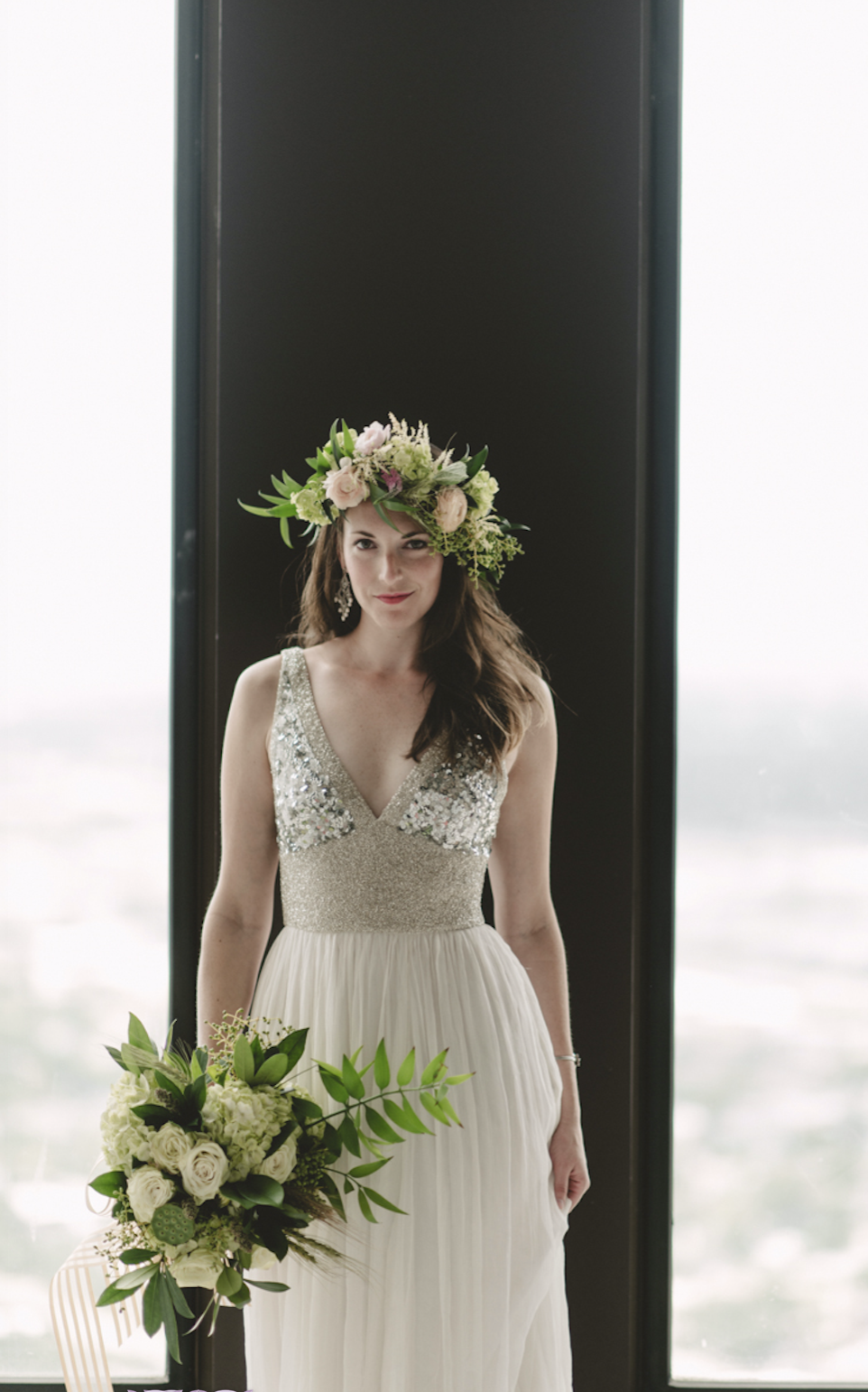 An all white/ivory bouquet is really popped by the colorful flower crown on this bride.