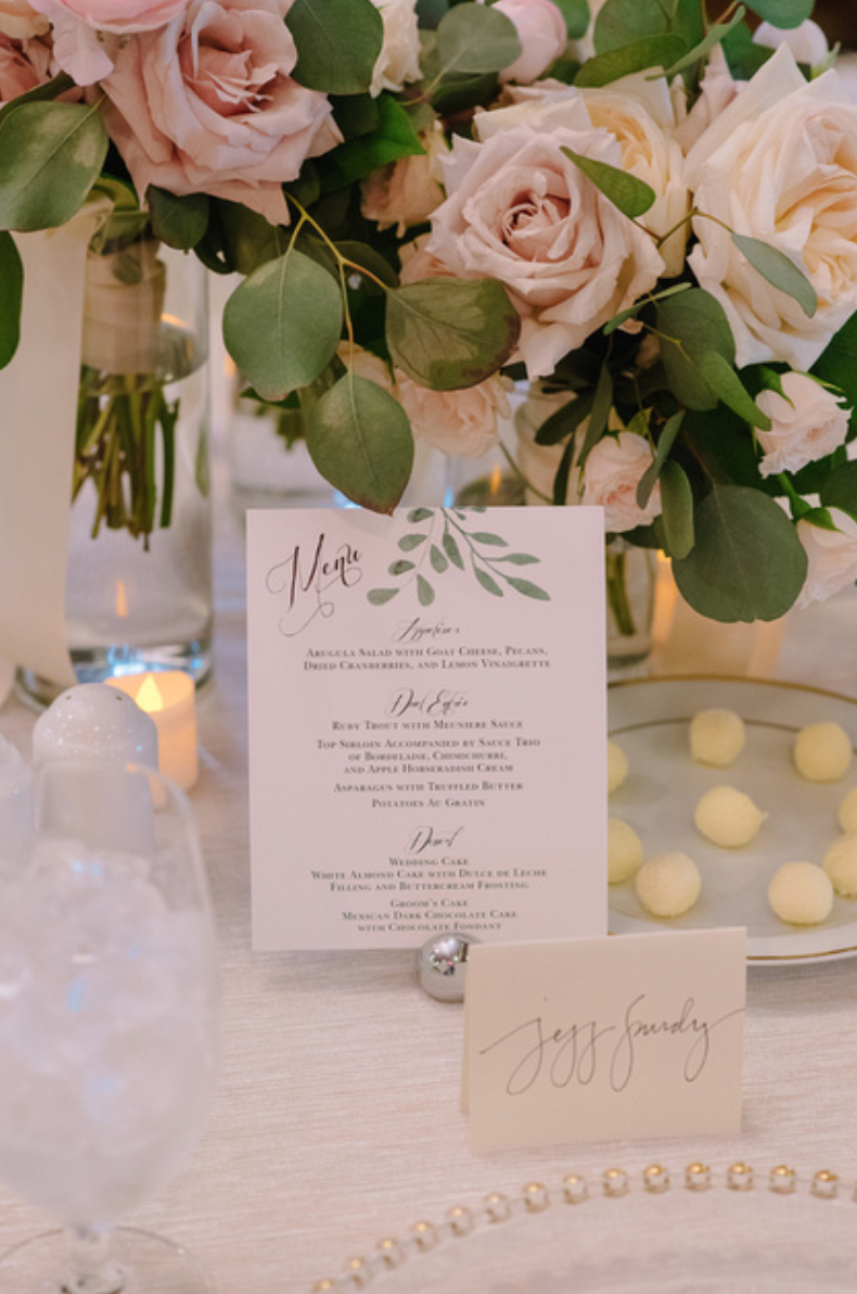 Menu is highlighted by the floral arrangement on the gold tablecloth.