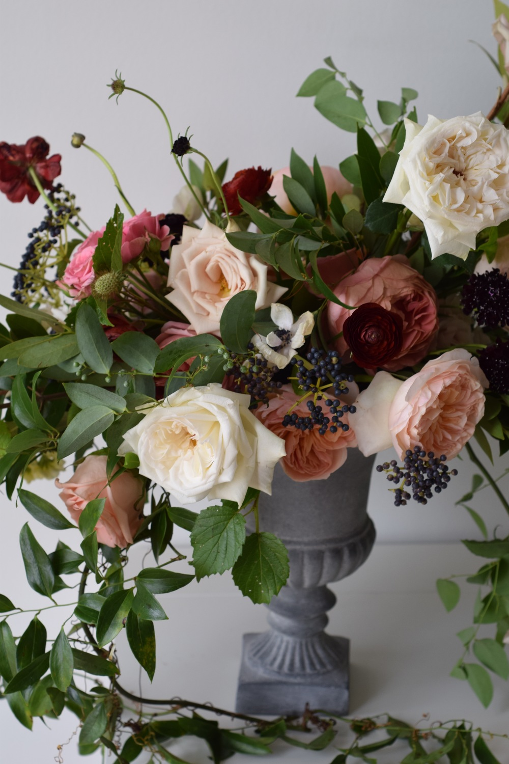 Compote arrangement featuring roses and berries. Maxit Flower Design in Houston Texas
