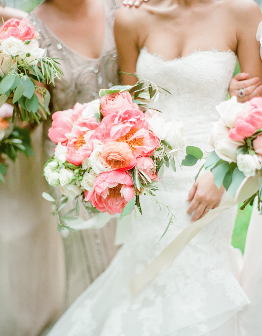 Close-Up of the pink, coral and greenery bouquets by Maxit Flower Design.