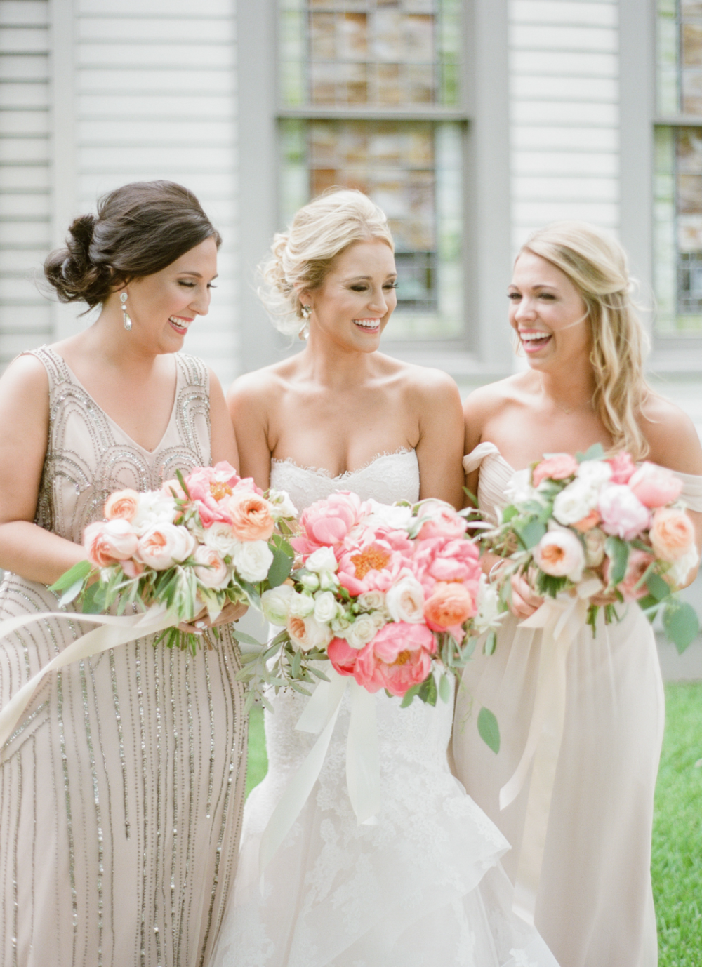 Bride & Bridesmaids in gold dresses with pink bouquets by Maxit Flower Design in Houston, TX
