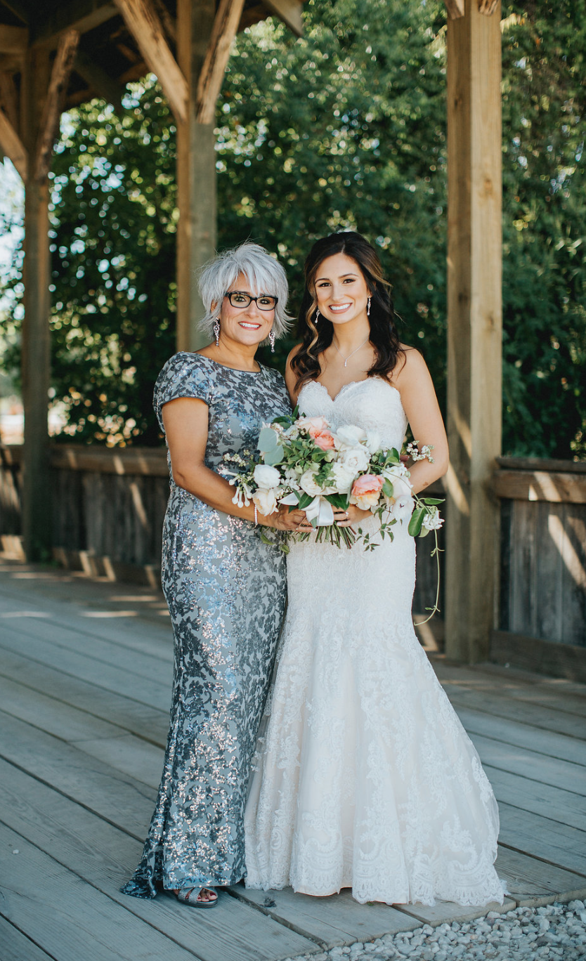 A mom and her blushing bride. Bridal Bouquet by Maxit Flower Design in Houston, TX