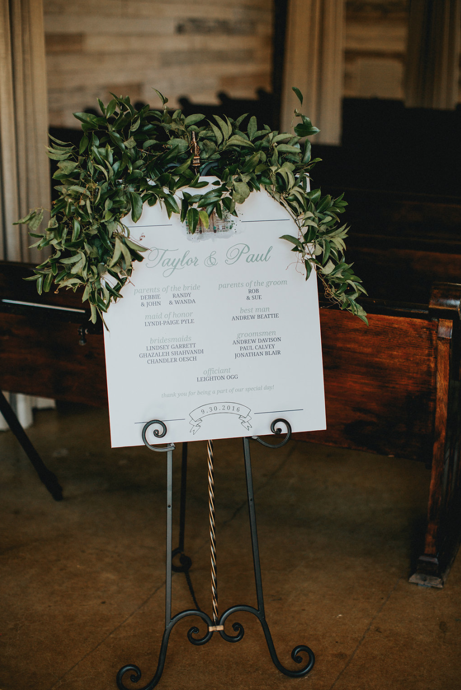 Ceremony program draped with greenery for the ceremony. By Maxit Flower Design in Houston, TX