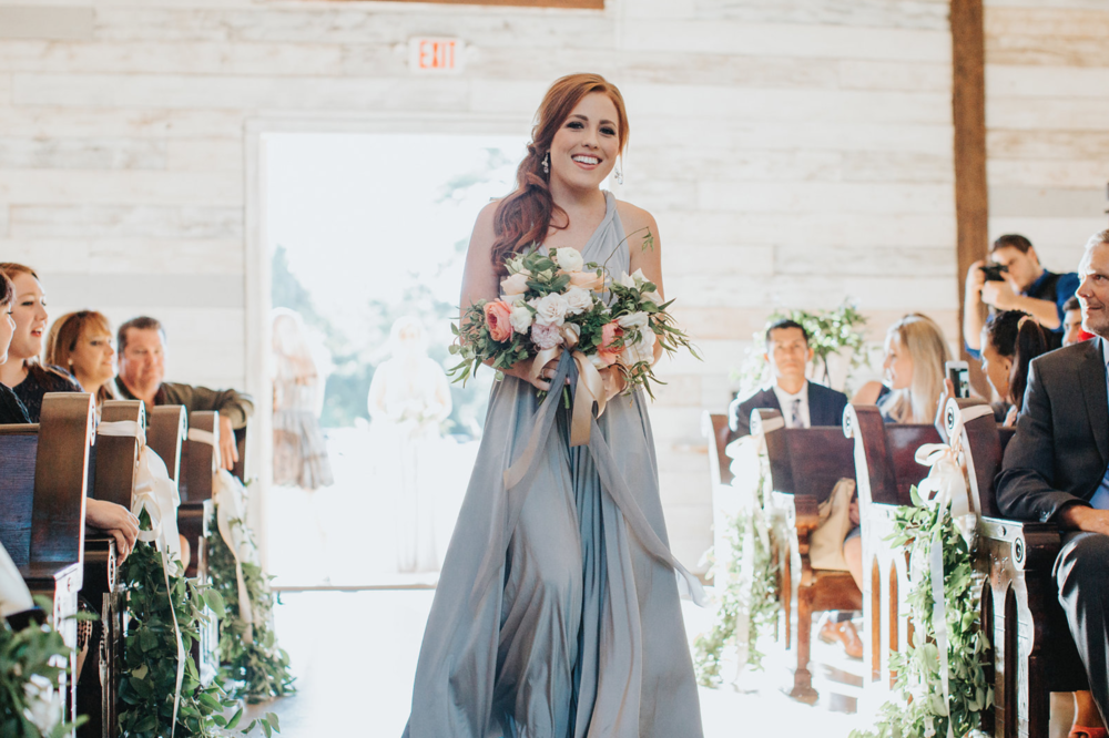 Beautiful bridesmaid with her bouquet by Maxit Flower Design at Big Sky Barn