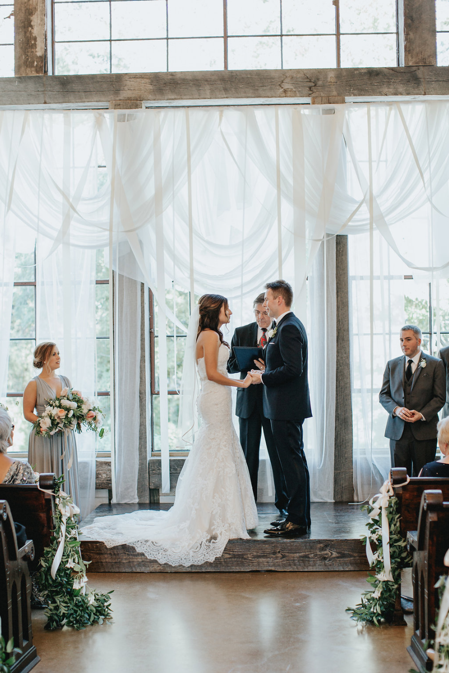 Exchanging Vows during the ceremony- all florals by Maxit Flower Design