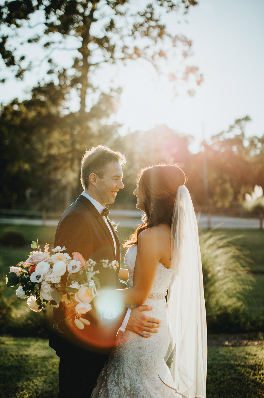 The perfect lighting shining on the newlyweds. Bridal Bouquet by Maxit Flower Design in Houston, TX.