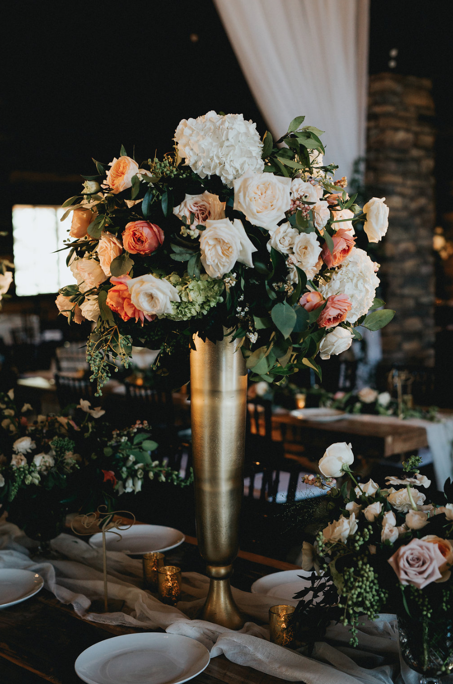Tall centerpiece and small floral arrangements by Maxit Flower Design in Houston, TX