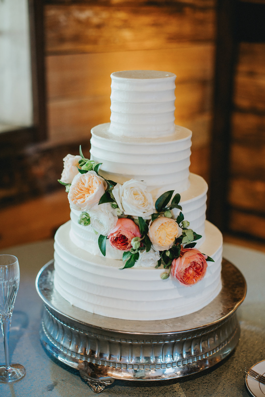 Simple cake with floral accents provided by Maxit Flower Design