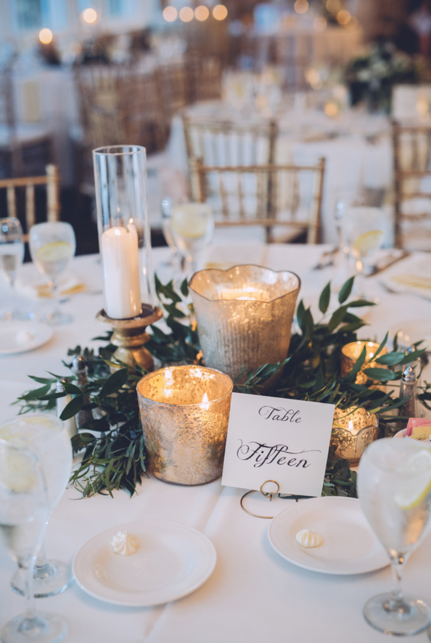 Using candles and a few sprigs on greenery on your table is a cost-efficient alternative. Photo by:  Danielle Nowak Photography.