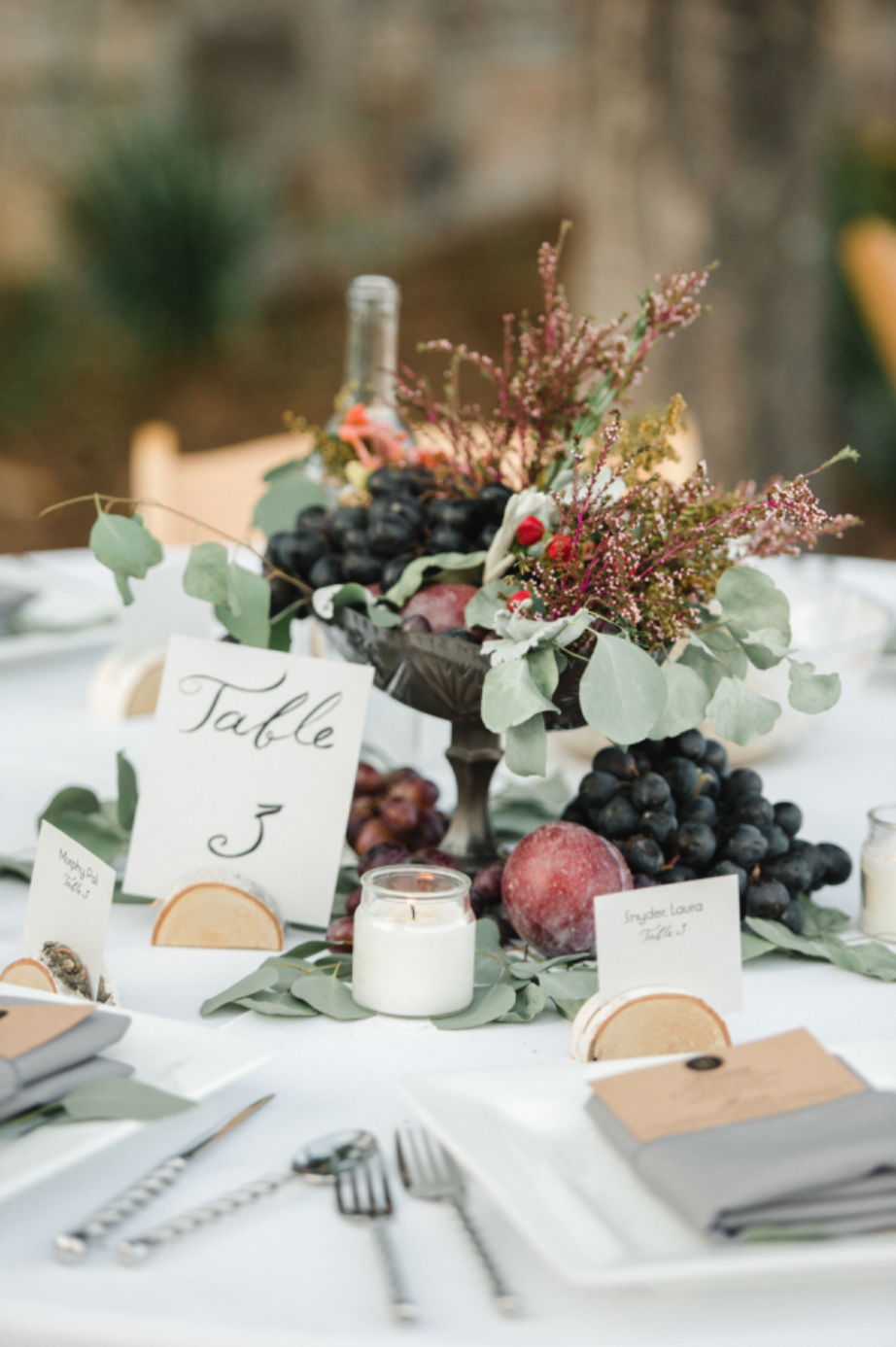 Using fruit and/or veggies in your centerpiece is a fun & interactive way to wow guests. Photo by: Rebecca Hollis Photography