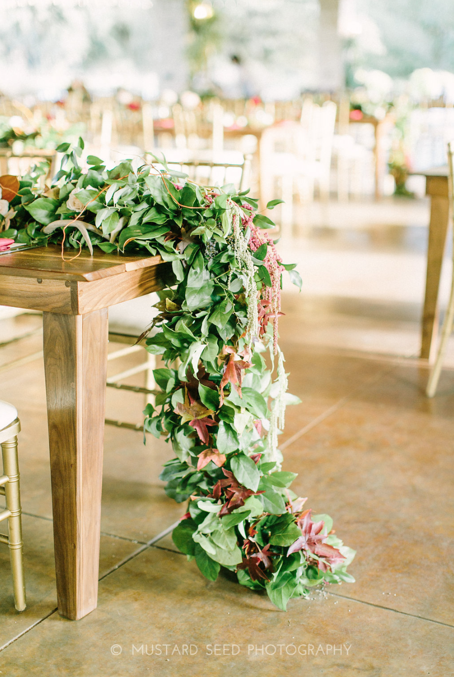 Floral Garland on a wooden table at Houston Oaks Country Club by Maxit Flower Design in Houston, TX.