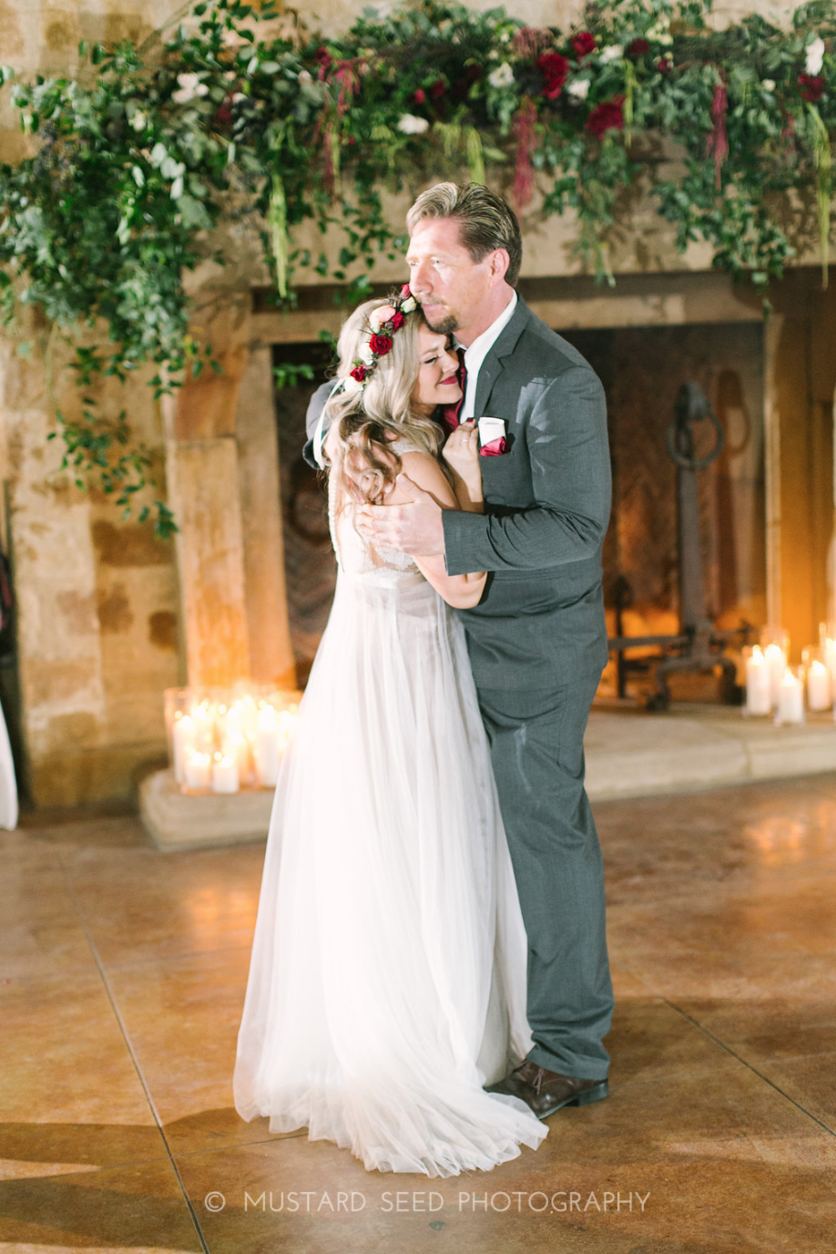 Sweet moment between daughter and father. Fireplace florals by maxit flower design in houston, tx