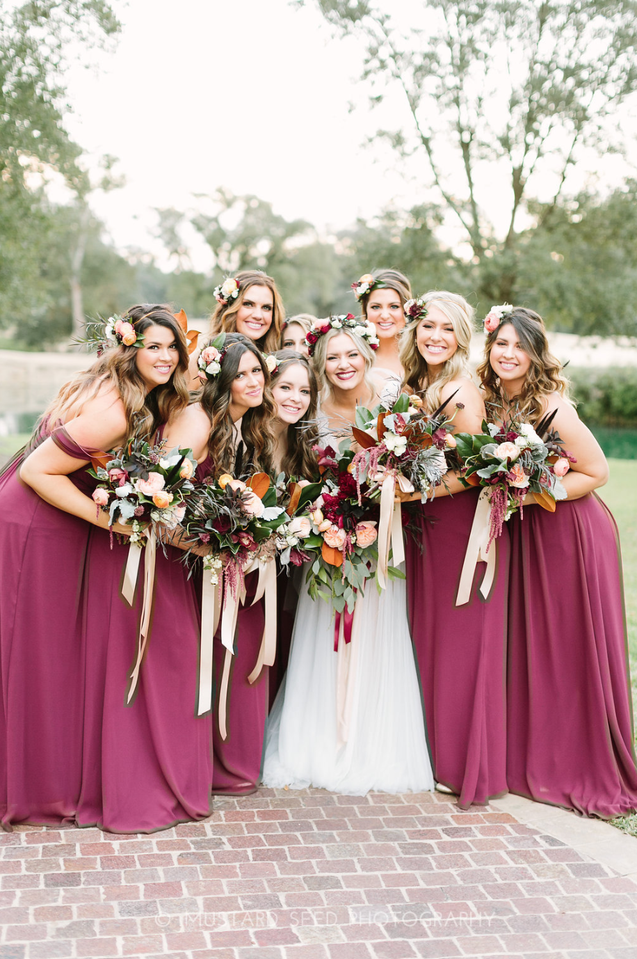 Bridal Party posing with their bouquets by maxit flower design in Houston, TX