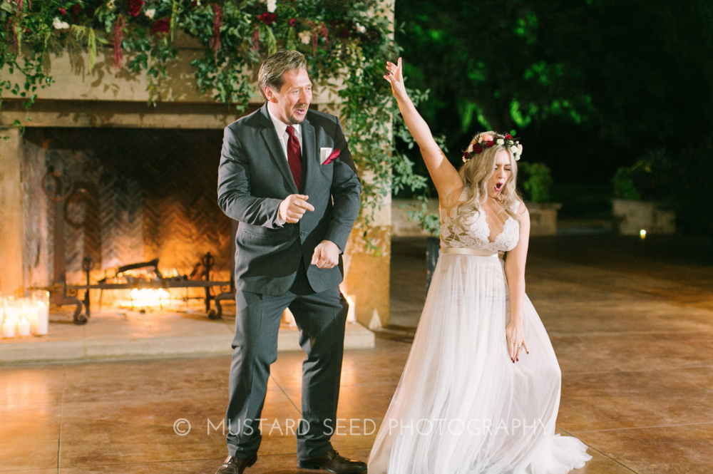 Fun moment during the father-daughter dance. Floral installation by Maxit Flower Design in Houston, TX.