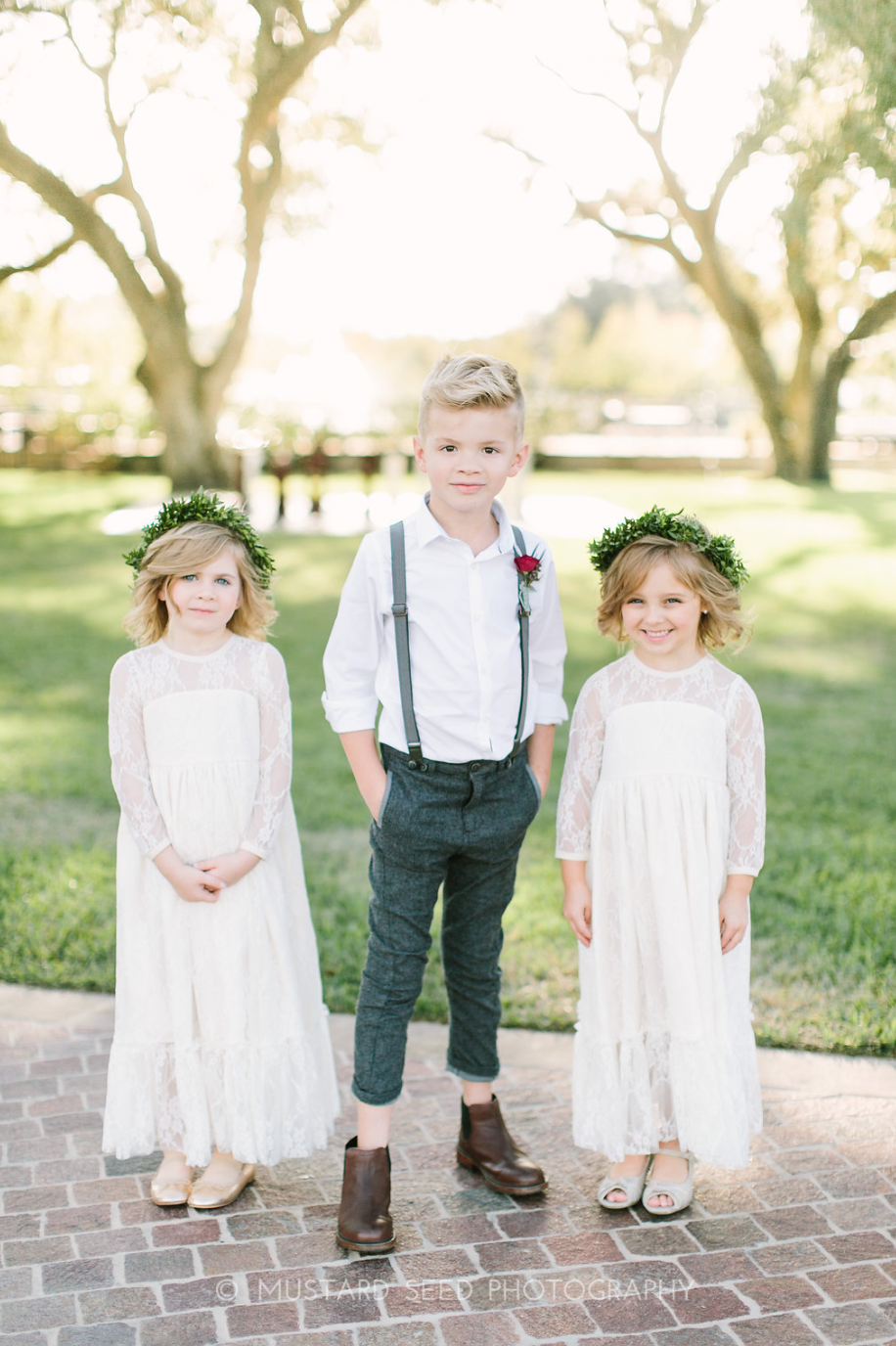 Flower Girls with flower crowns and Ring bearer in suspenders