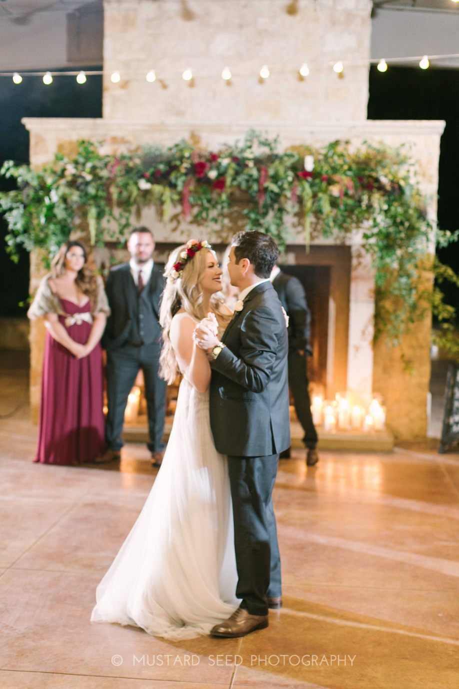 First Dance in front of a fireplace.