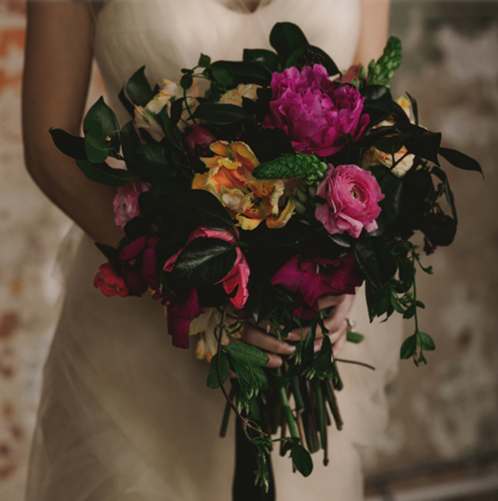 Bridal Bouquet with pink, orange, red & greenery. By Maxit Flower Design in Houston, TX.