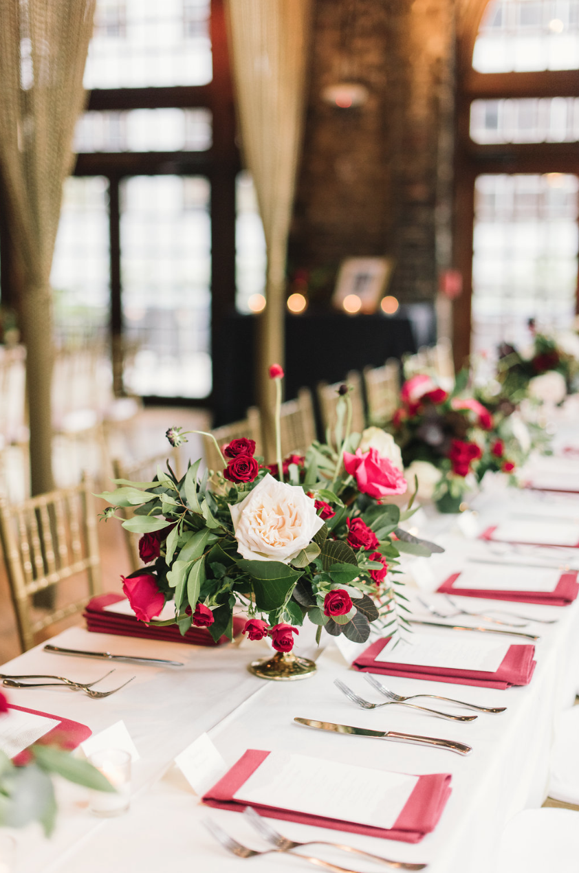The calm before the storm. Florals by Maxit Flower Design. Red and blush flowers with red napkins.
