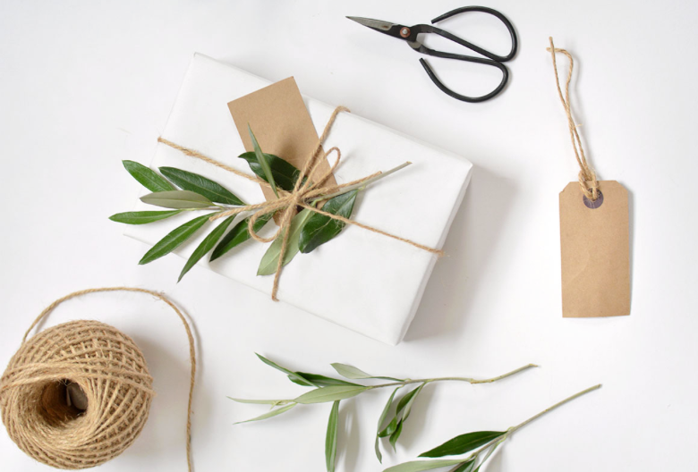 Simple Wrapping DIY: Use white paper, tie with twine and add a sprig of greenery.