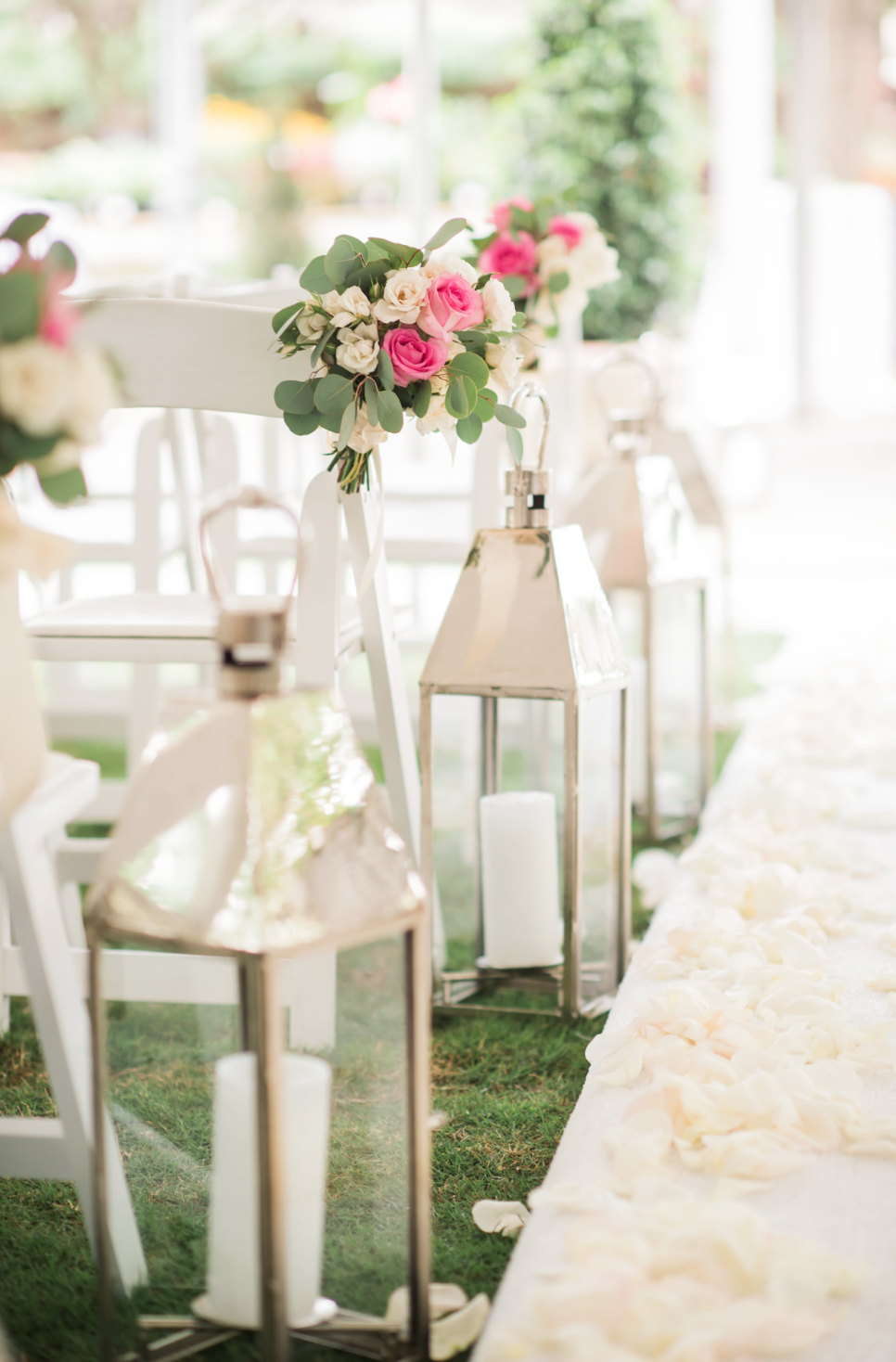 Silver lanterns lined the aisle at C+G's ceremony. Small arrangements hung from the chairs.