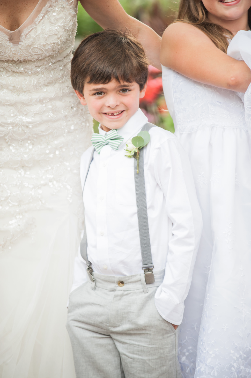 Ring bearer with suspenders.