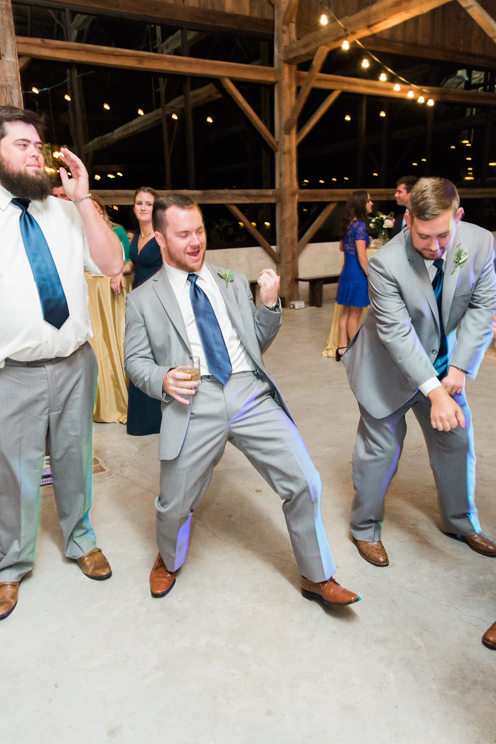 Air band moment between the groomsmen.