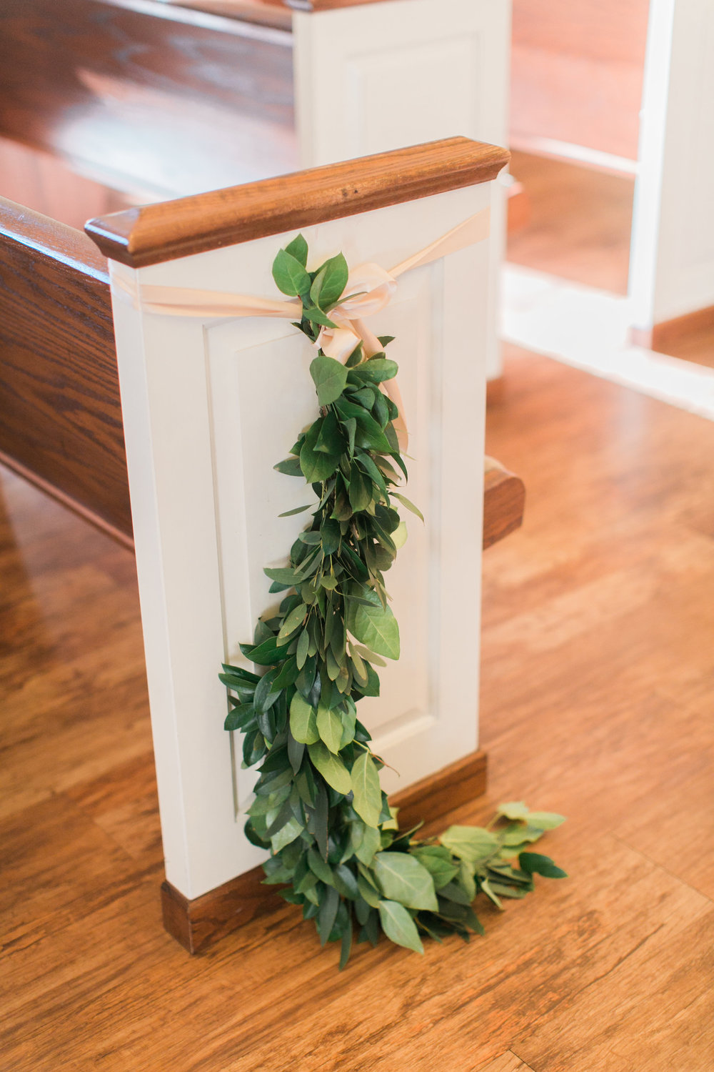 greenery on pews from maxit flower design
