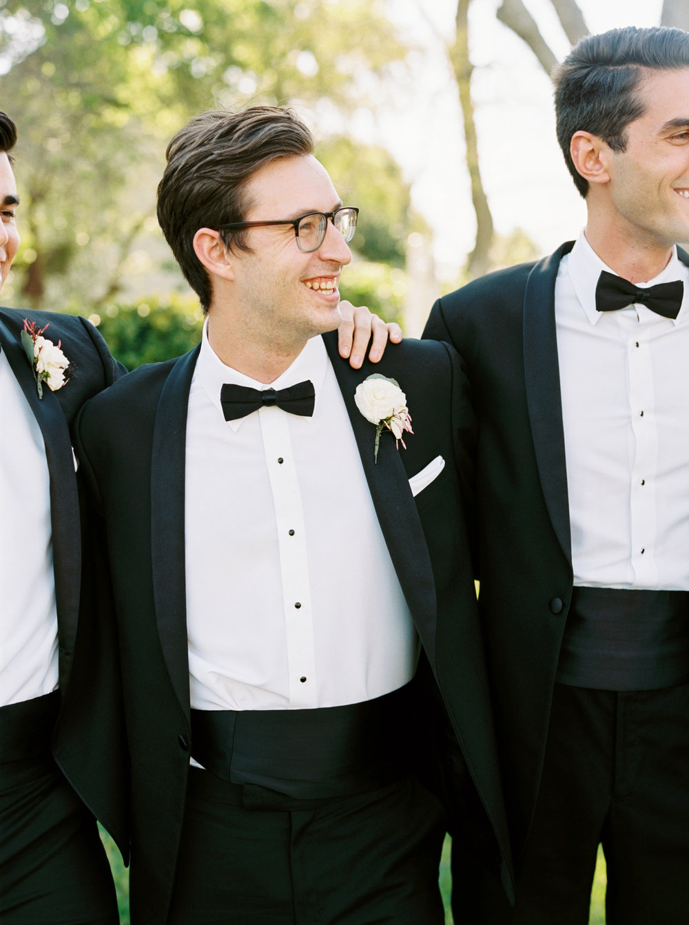 best man in black tux with white boutonniere by maxit flower design in houston texas