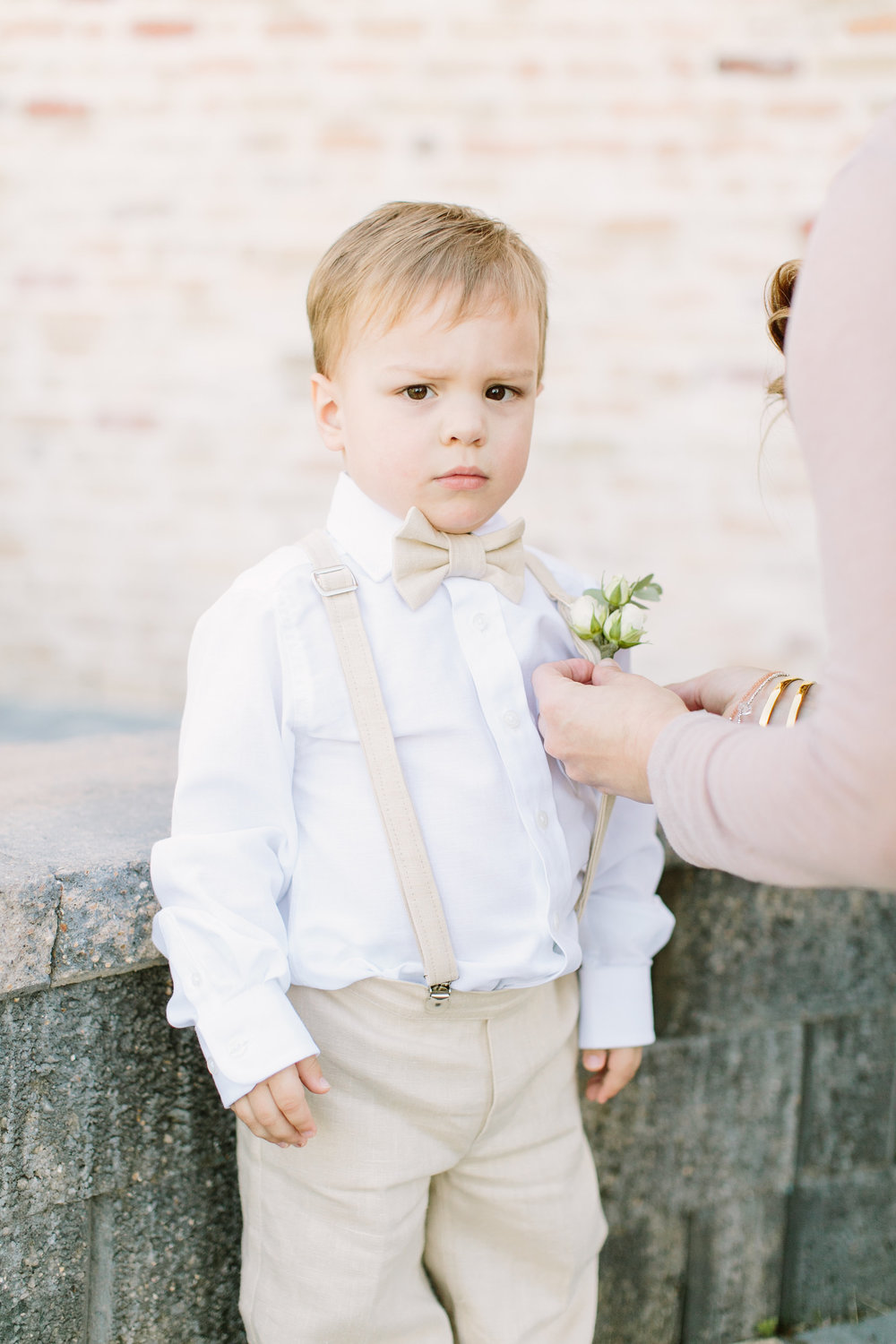 ring bearer with mini boutonniere by maxit flower design in houston texas