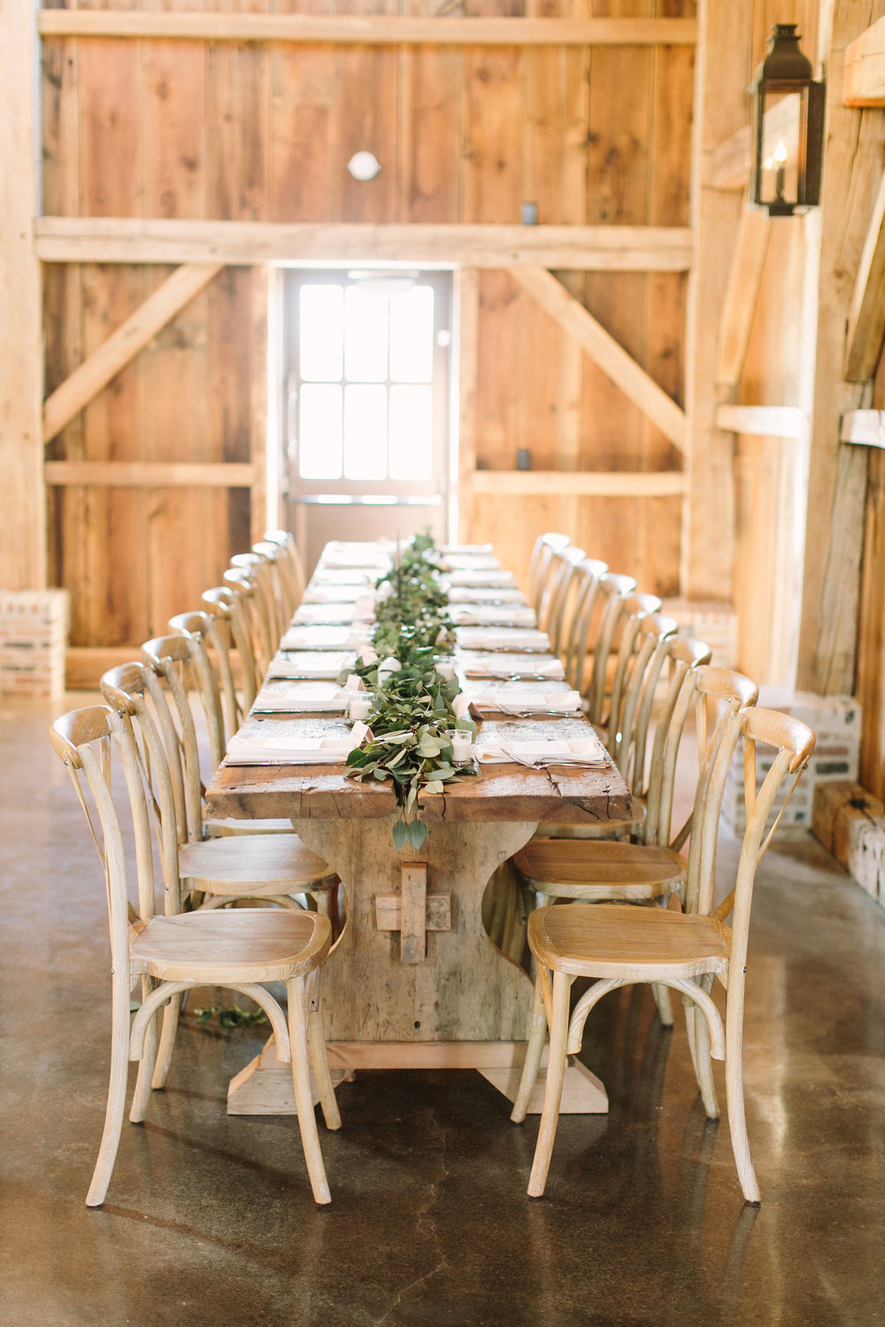 farm table with greenery garland by maxit flower design in houston texas