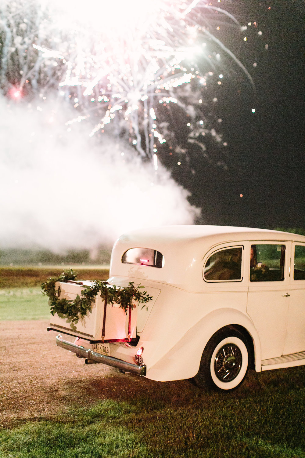 bride and groom get away car by maxit flower design houston texas