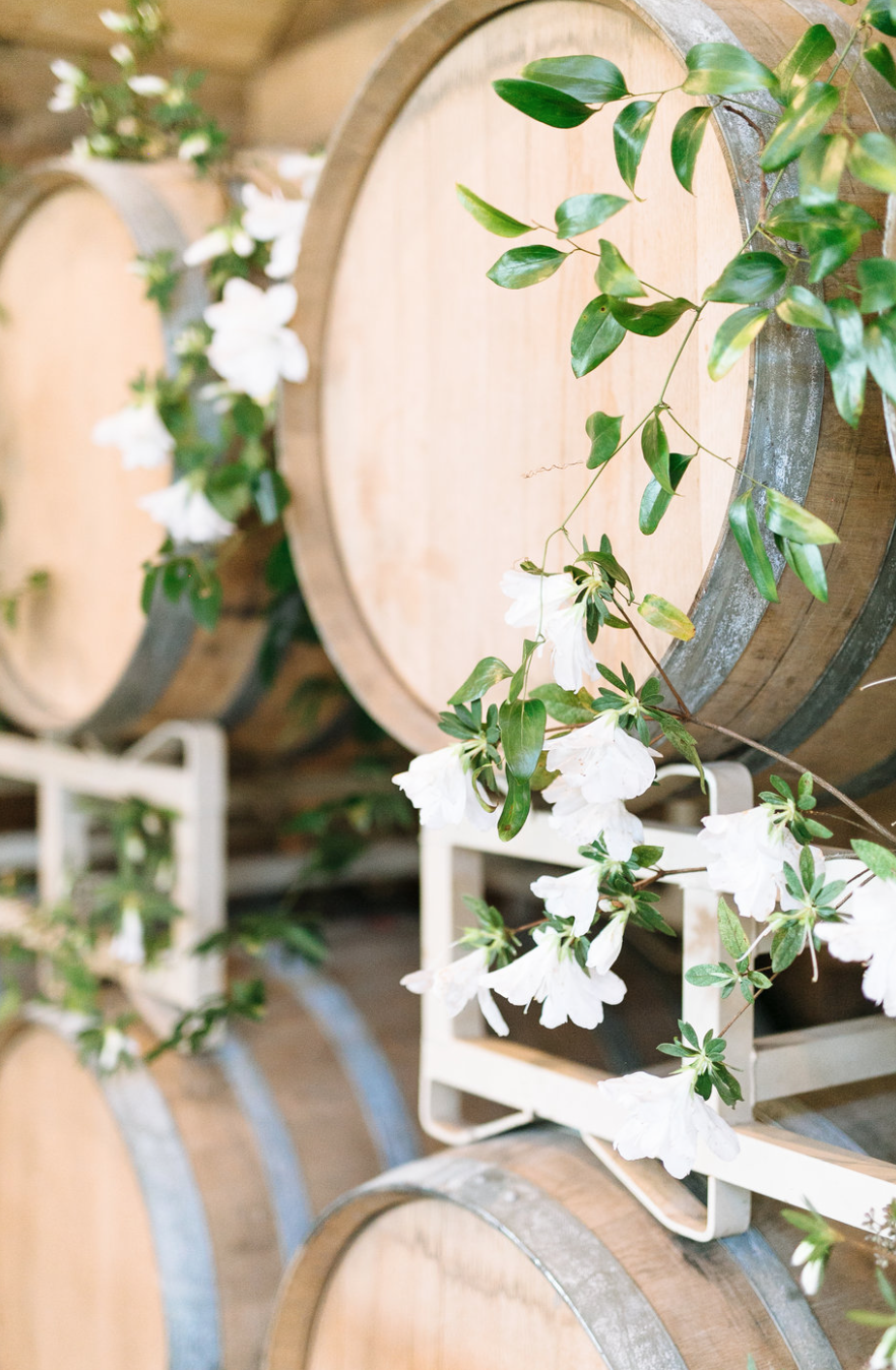 wine  barrels with greenery by maxit flower design in houston texas