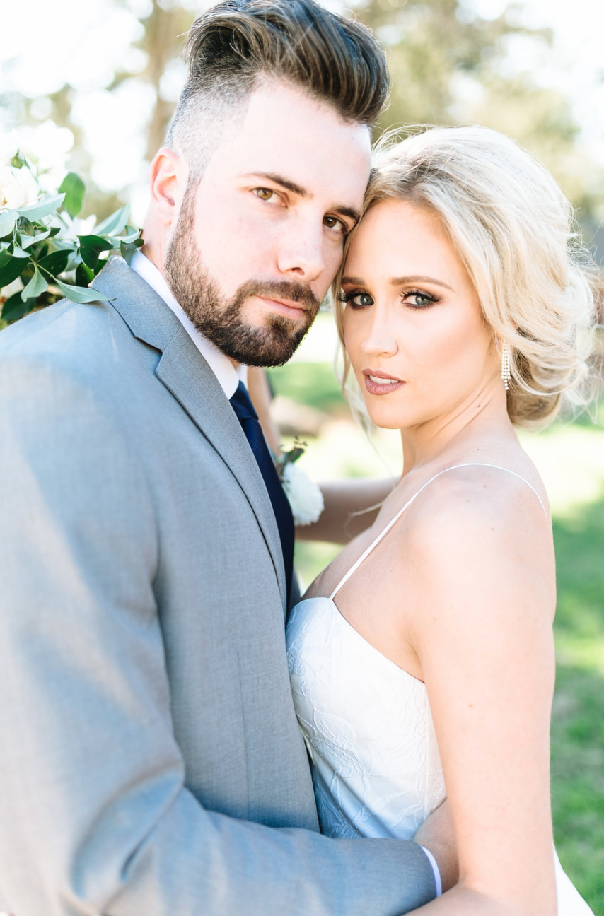 couple after wedding florals by maxit flower design in houston texas