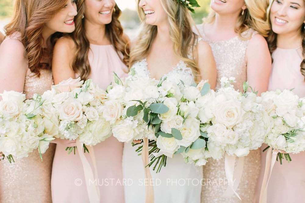 bridesmaids-in-blush-dresses-with-bouquets-by-maxit-flower-design-in-houston-texas