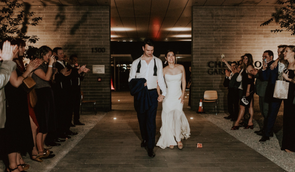 bride-groom-exit-centennial-gardens-modern-wedding-moody-photography-joseph-west-maxit-flower-design-in-houston-texas