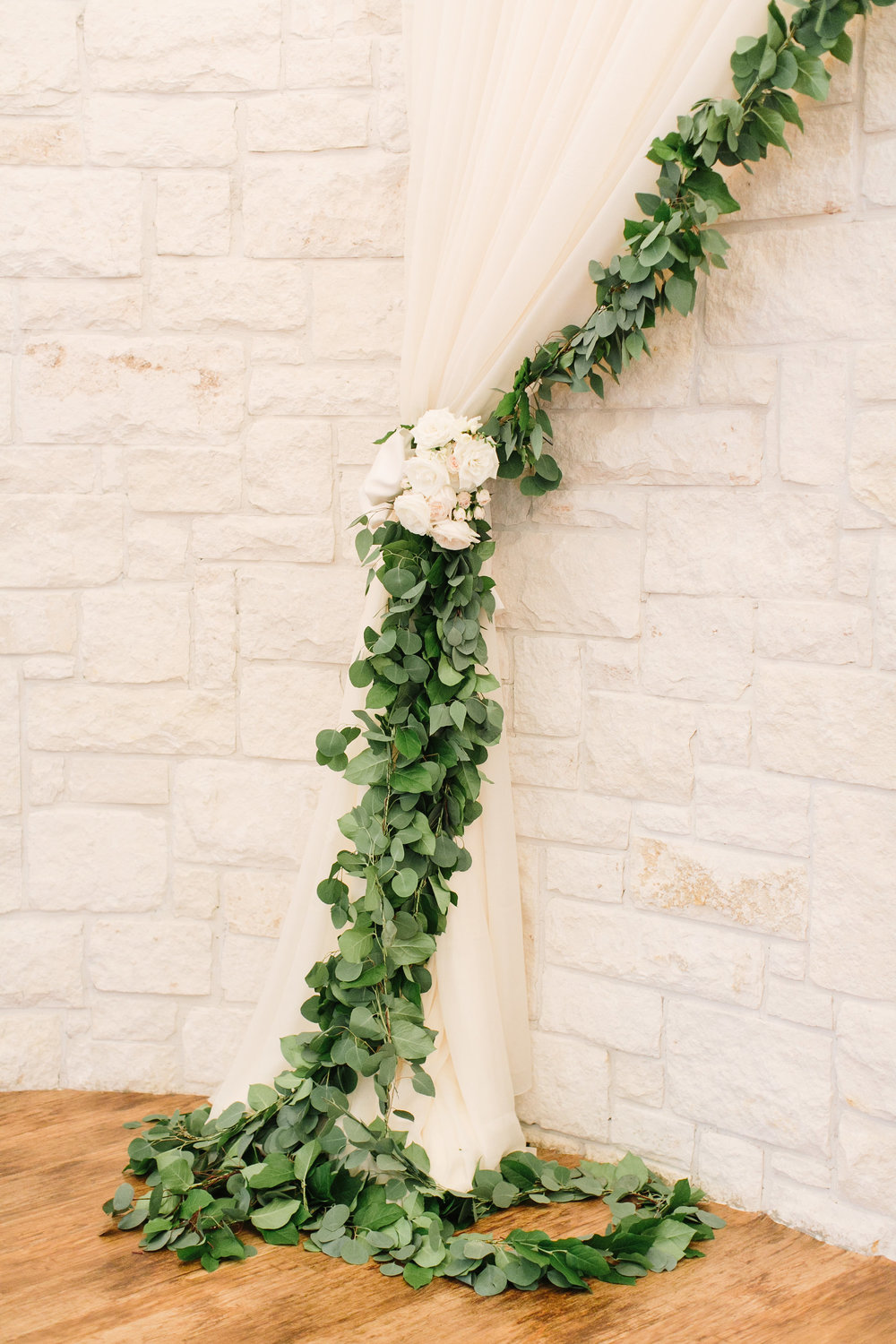 ceremony-altar-decor-detail-garland-greenery-white-floral-by-maxit-flower-design-in-houston-texas