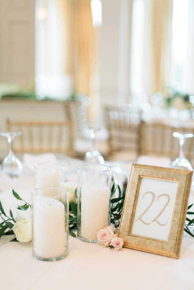 wedding-details-photography-dana-fernadez-river-oaks-country-club-table-number-gold-pillar-candle-reception-decor-floral-greenery-by-maxit-flower-design-houston-texas