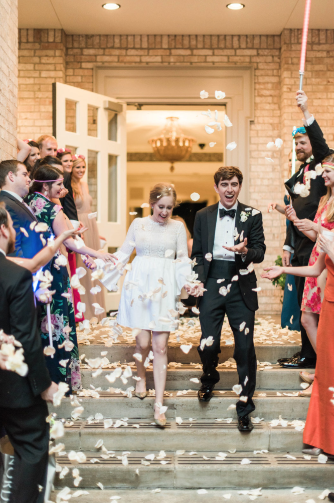 wedding-bride-groom-reception-exit-photography-dana-fernadez-river-oaks-country-club-rose-petals-floral-greenery-by-maxit-flower-design-houston-texas