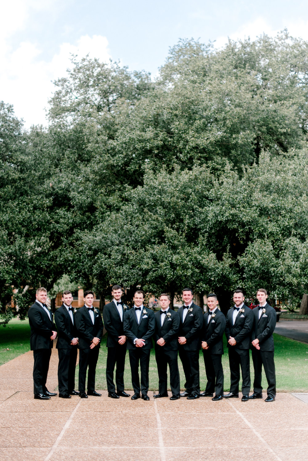 wedding-details-photography-dana-fernandez-groom-groomsmen-tux-bowtie-boutonniere-floral-greenery-by-maxit-flower-design-houston-texas