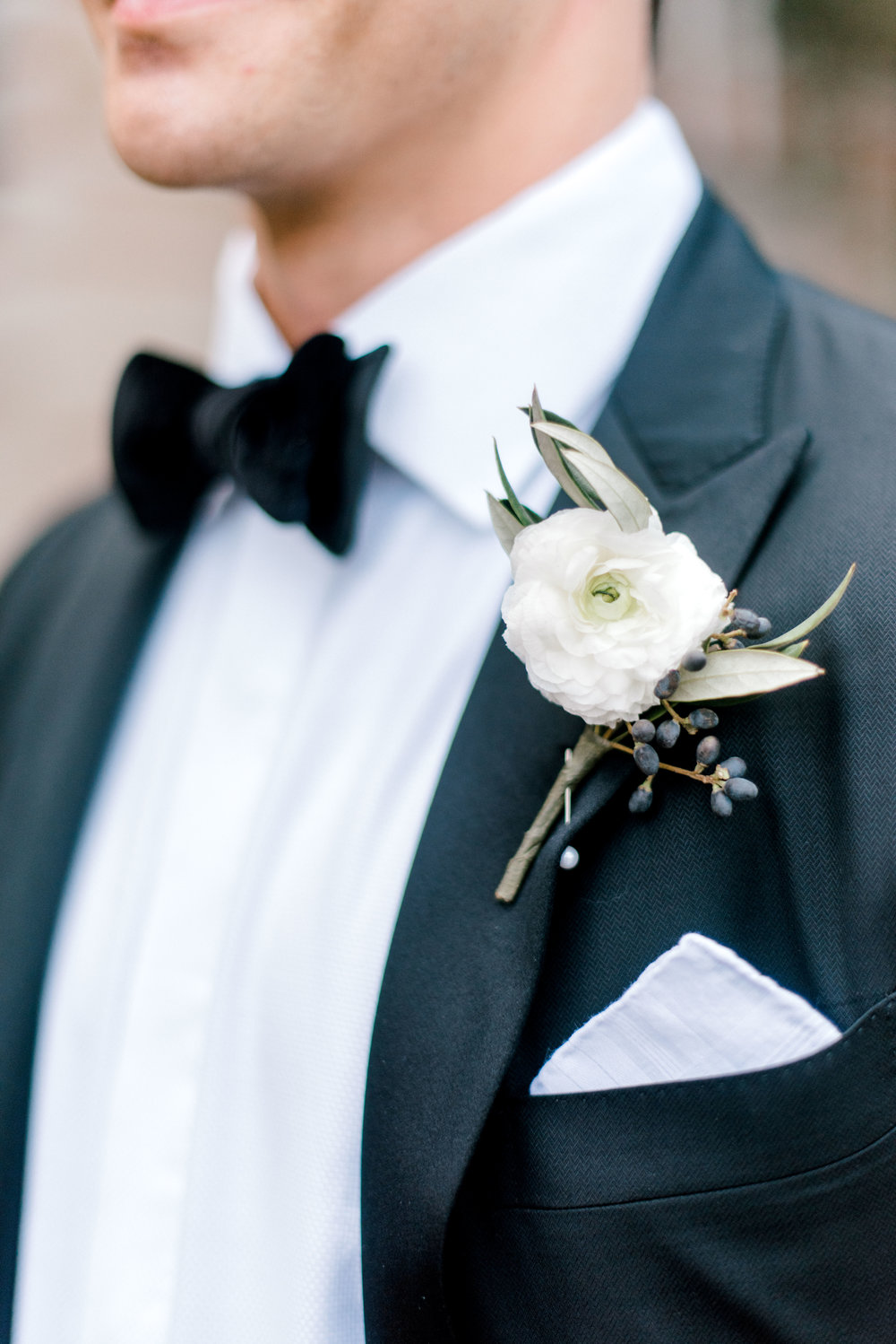 wedding-details-photography-dana-fernandez-groom-bowtie-tux-Ranunculus-berry-texture-pocket-square-floral-greenery-by-maxit-flower-design-houston-texas.jpg